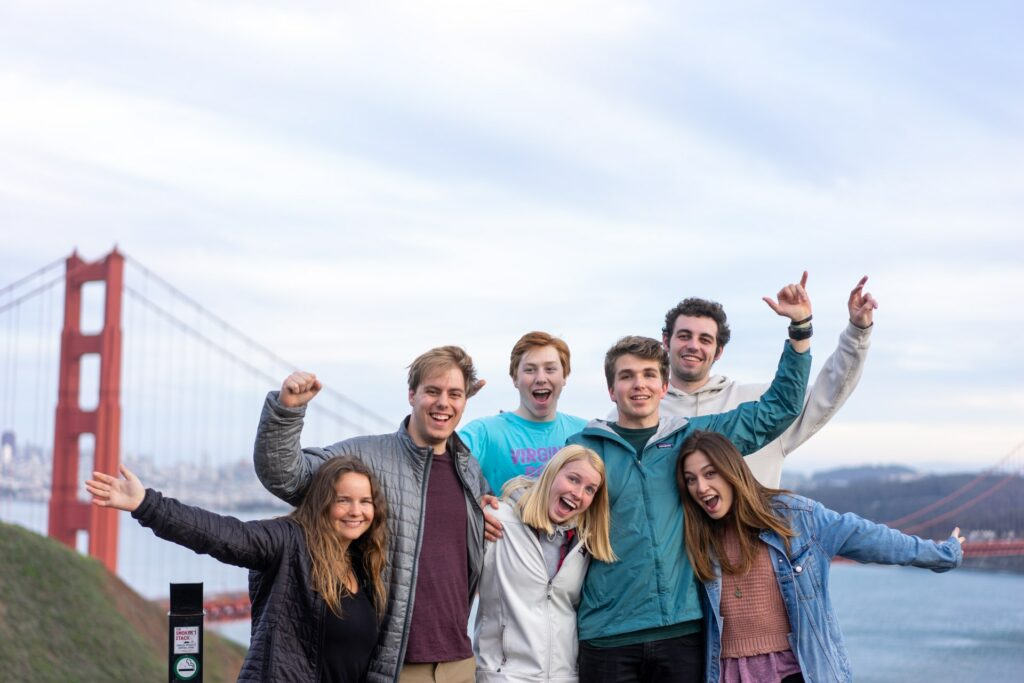 A group family photo by the Golden Gate Bridge.