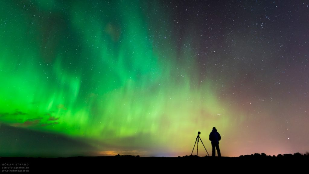 Photographing the northern lights.