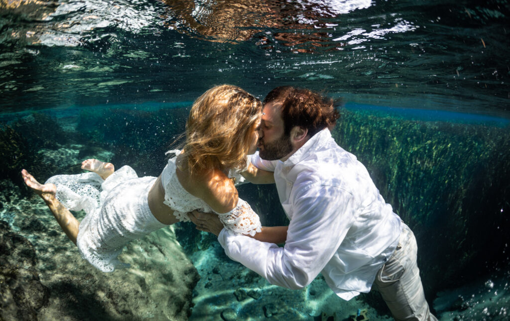 Underwater photos for a wedding are an unforgettable experience.