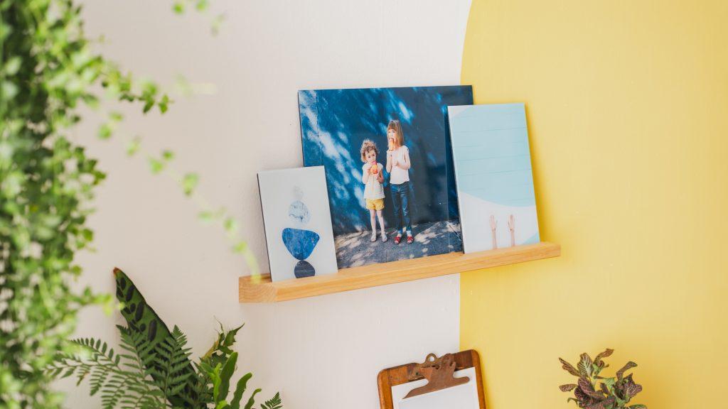 Glass prints on a Storyboard shelf